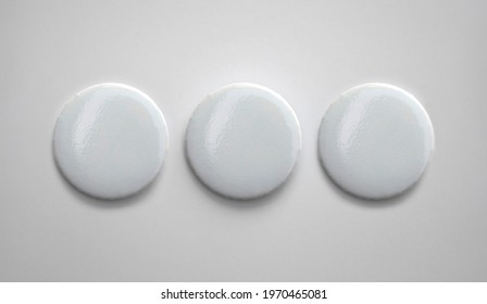 White pin button. Pin button set. Collection of realistic pin buttons. White blank badge pin brooch isolated on white background. Photo of badge.Badge Mock-up isolated on background.