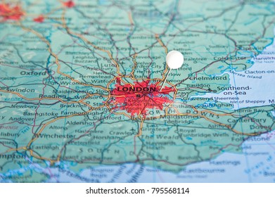 White pin on map with London