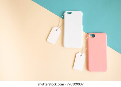 White and pink color of iPhone case with price tag on colorful background