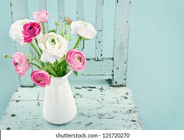 White and pink flowers on light blue vintage chair