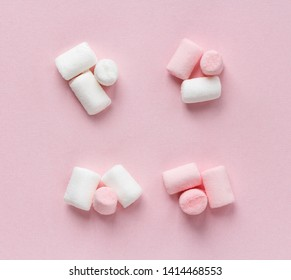 white and pink marshmallows on pink background