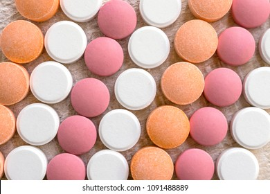 White, pink and orange tablets stripes background. Different Antacids medications help neutralize stomach acid. Antacid Oral : Uses, Side Effects, Interactions, Risks, Warnings