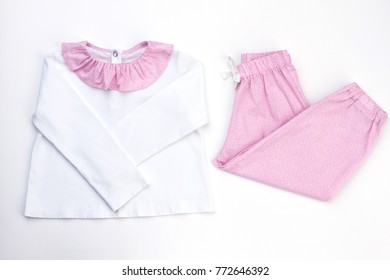 White and pink pajama set. Soft cotton jacket and loose-fitting pants with drawstring. Wear for good night's rest.