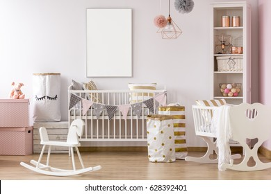 White and pink, pastel baby room with cot and cradle