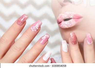 White pink pastel manicure and lip makeup with close-up rose stickers on girl.Nail art.