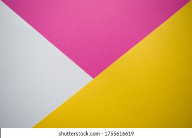 White, pink and yellow background divided diagonally