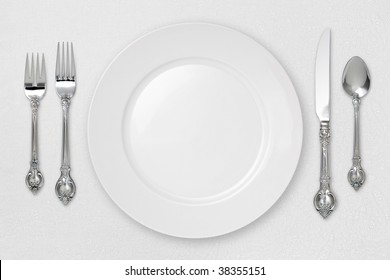 White Place Setting on tablecloth with a clipping path