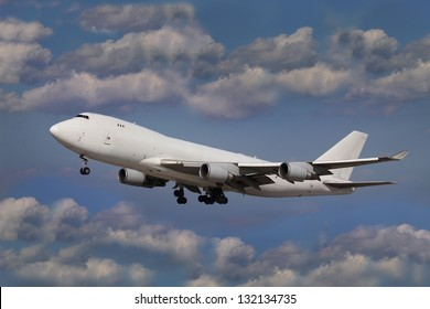 White plane in the blue sky with clouds