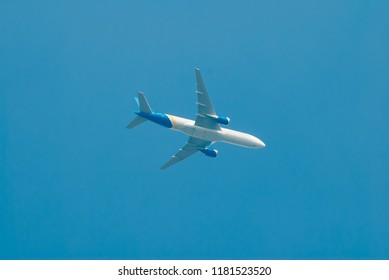 a white plane with a blue tail