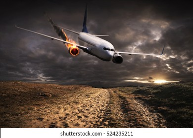 White plane with engine on fire about to crash in the landscape