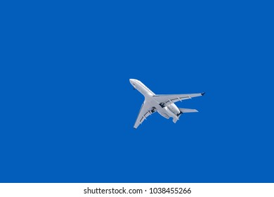 White Plane with Landing Gear in the Sky