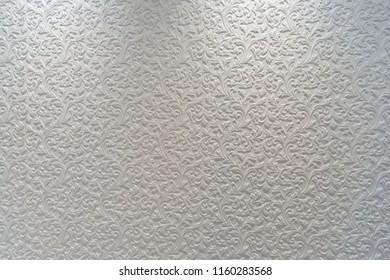 White plaster background floral pattern