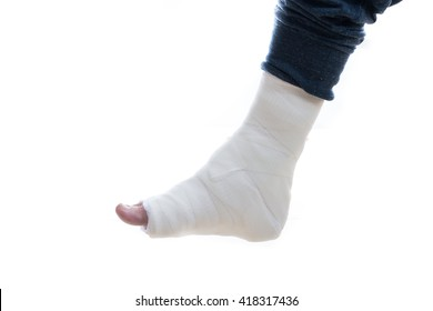 White plaster and fiberglass leg cast worn by a young man(isolated on white)