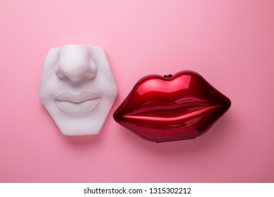 White plaster mouth model and red shiny female mouth lips, beauty standards concept or lips augmentation