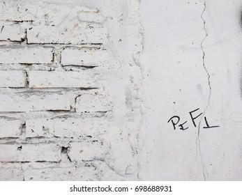 White plaster over brick texture