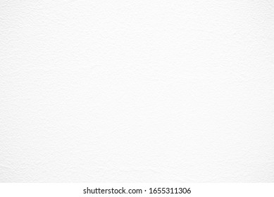 White Plaster Stucco Wall Texture Background with Grains.