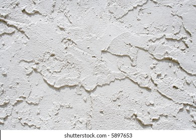 White plaster texture on the wall of a building.