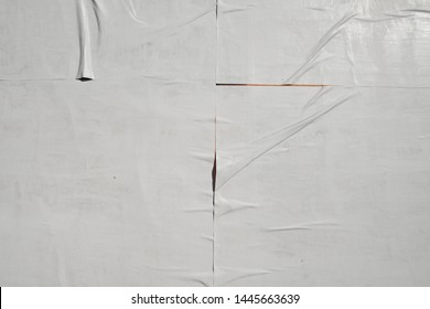 white plastered glued poster wall