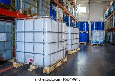 White plastic barrel. Barrel on a pallet with a metal frame. Shipment of chemicals. Plastic container for liquids.