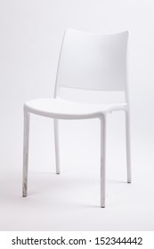 white plastic chair on isolated