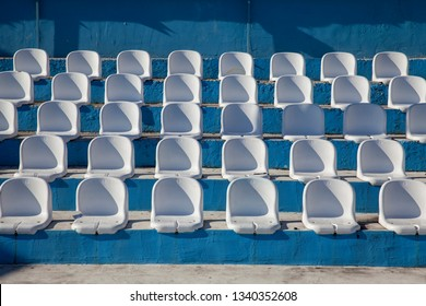 White plastic chairs in the stands, close up