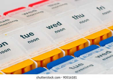 A White Plastic Pill Box Showing the Days of the Week
