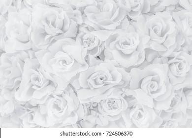 white plastic roses