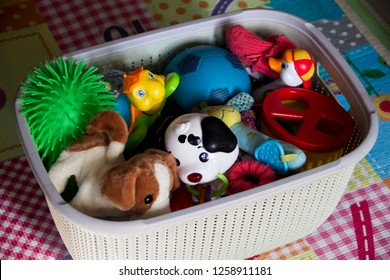 White plastic toys basket with playing mat
