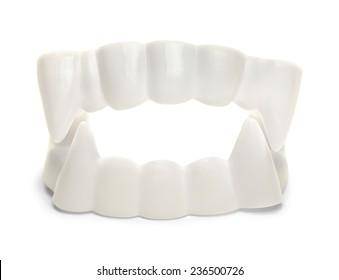 White Plastic Vampire Teeth Isolated on White background,