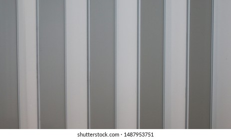 White plastic wall in the room.
