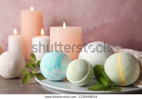 White plate with bath bombs and mint leaves on table