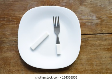 white plate with broken fork on it
