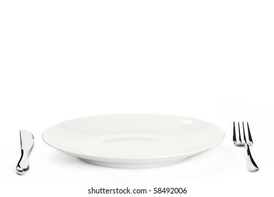 white plate with cutlery on white background