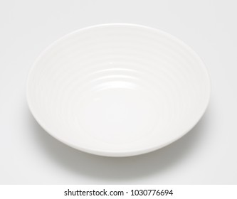 White plate for food on a white background