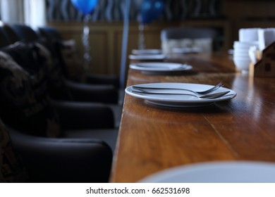 white plate and fork on table in restaurant
