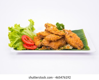 A white plate with fresh, crispy fried chicken wing