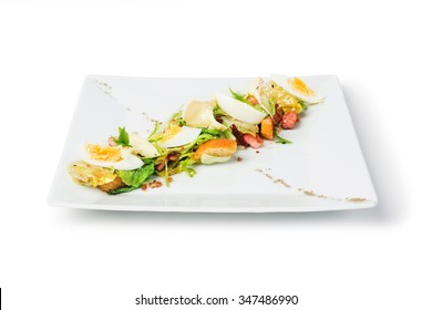 White plate of a fresh salad isolated on white background