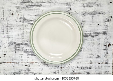 A white plate. An object. Clean. for food. View from above. For your design.