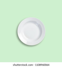 white plate on color background