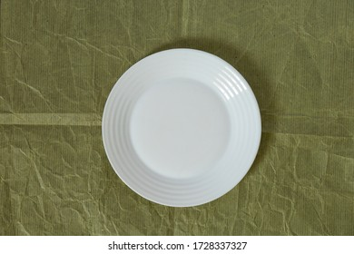 white plate on isolated light background close-up