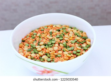 white plate with peas and lentils on white background