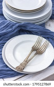 White plates on a blue tablecloth