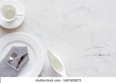 White plates and sauce boat for table setting on marble background top view mockup