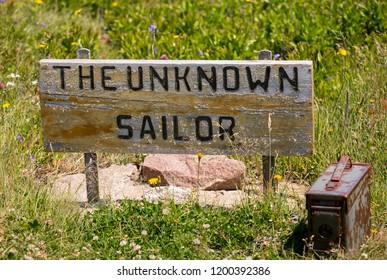 WHITE POINT, CAPE BRETON, NOVA SCOTIA, CANADA - JULY 20, 2018: The Unknown Sailor marker in coastal cemetery.