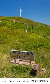 WHITE POINT, CAPE BRETON, NOVA SCOTIA, CANADA - JULY 20, 2018: The Unknown Sailor marker in White Point cemetery on coast.