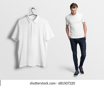 White polo on a man in jeans, isolated mockup. Hanging blank polo, t-shirt against empty wall.