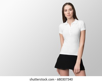 White polo on a young woman in black skirt, isolated, with copy space, mockup.