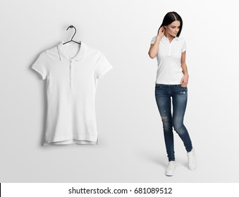 White polo on a young woman in jeans, isolated mockup. Hanging blank polo, against empty wall.