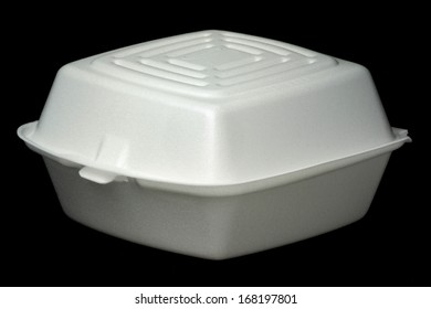 White polystyrene fast food container isolated on black.
