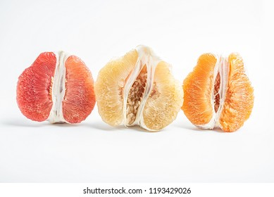 White pomelo red pomelo and golden grapefruit on white background